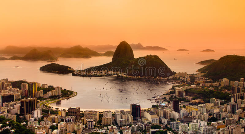 Rio de Janeiro, Brazil. Suggar Loaf and Botafogo beach viewed from Corcovado at sunset stock photos