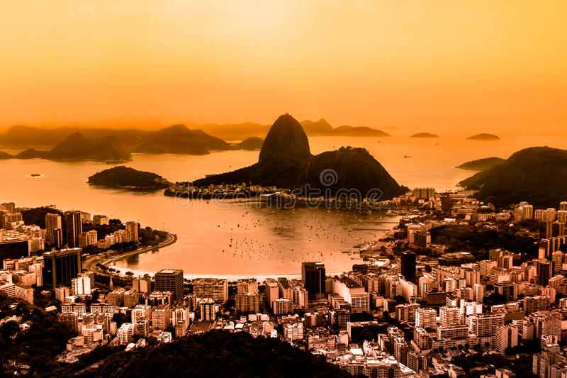 Rio de Janeiro, Brazil. Suggar Loaf and Botafogo beach viewed from Corcovado at sunset. Rio de Janeiro is the 2016 summer olympic games hosting city royalty free stock photos
