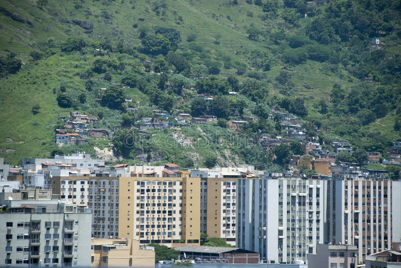 Rio de Janeiro contrast 2. The construction of fragile and illegal homes on the city mountains, creating the Favelas, started decades ago and never stopped royalty free stock photo