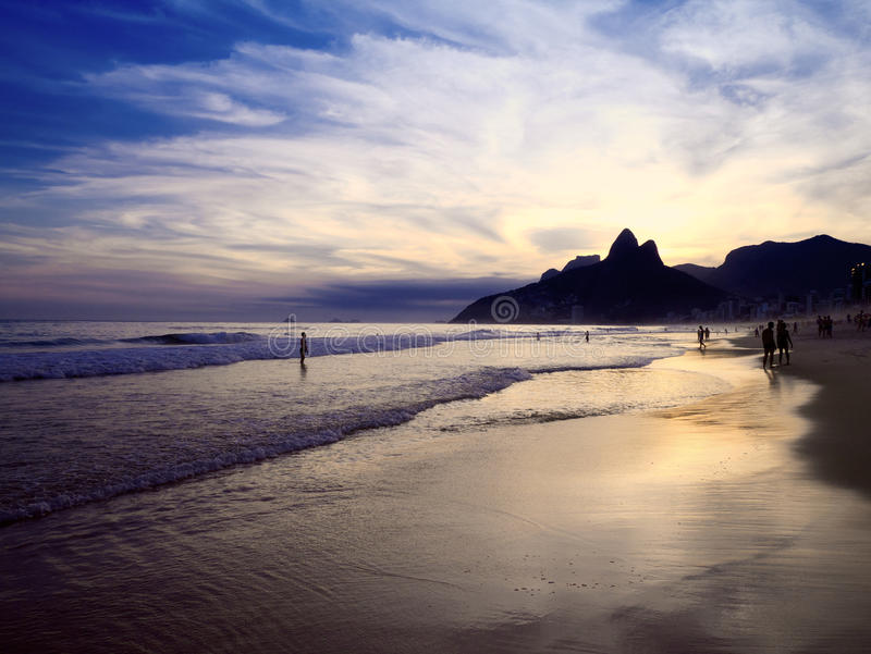Rio de Janeiro Ipanema Beach Scenic Dusk Sunset Reflection. Dusk sunset reflection of Rio de Janeiro Ipanema Beach Brazil with Two Brothers Dois Irmaos Mountain royalty free stock photos