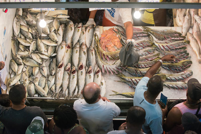 Rio de Janeiro. NITEROI, RJ/Brazil - APRIL 03, 2015: Selling fish in the popular market St. Peter during the Holy Week holiday. Buyers in front of the fish royalty free stock photo