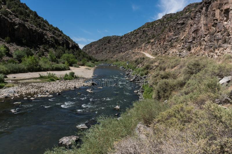 Rio Grande flowing south in New Mexico. The Rio Grande flows it`s way south towards the town of Taos in northern New Mexico royalty free stock photo