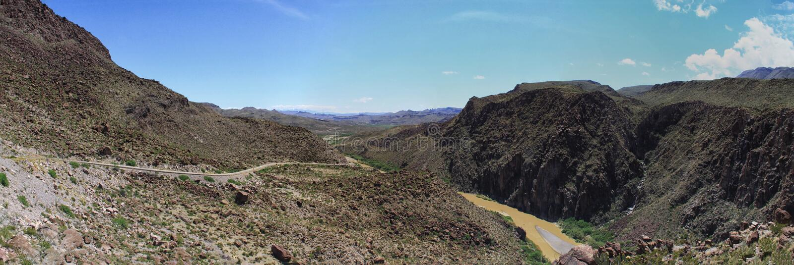 Rio Grande River on the Mexican and United States Border. Rocky shore and jagged cliffs along the Rio Grande river that shows the Mexico and United States Border royalty free stock photo