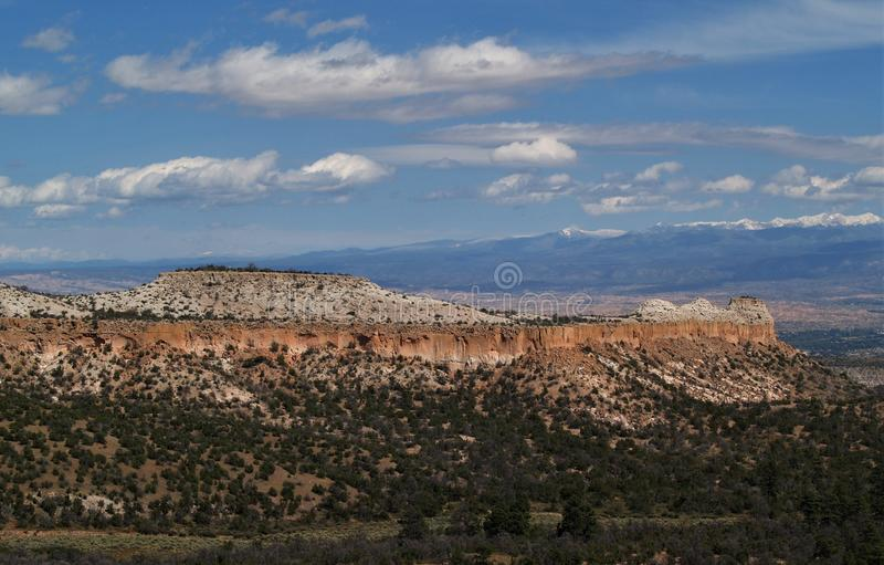 Rio Grande Valley. Near Los Alamos, New Mexico: scenic overlook on Senator Clinton P. Anderson Scenic Route - mesas with Sierra Mosca and other peaks in the royalty free stock images