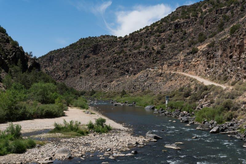 The Rio Grande Flows near Taos New Mexico. The Rio Grande view towards the south as seen near the John Dunn bridge in northern New Mexico royalty free stock photos
