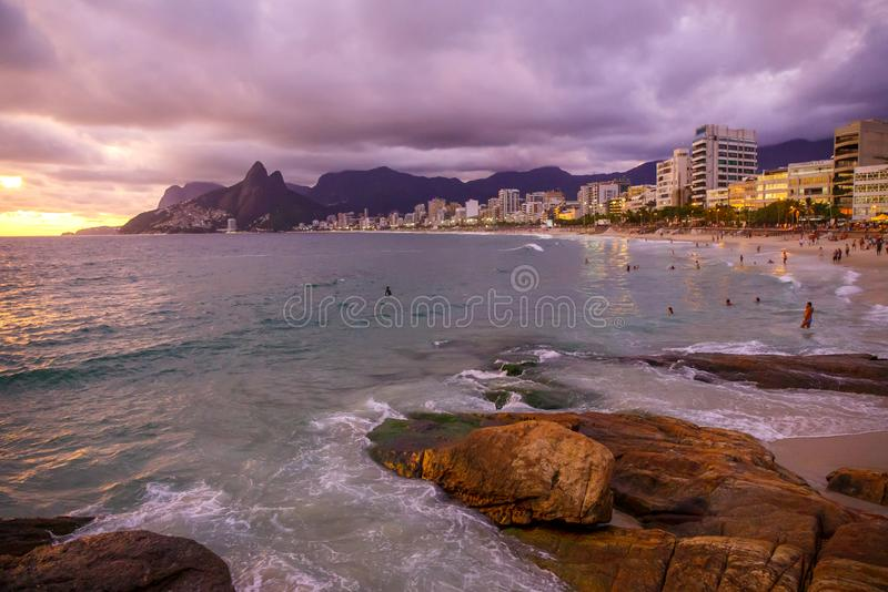 RIO`S CARNIVAL IPANEMA BEACH AT SUNSET. royalty free stock photography