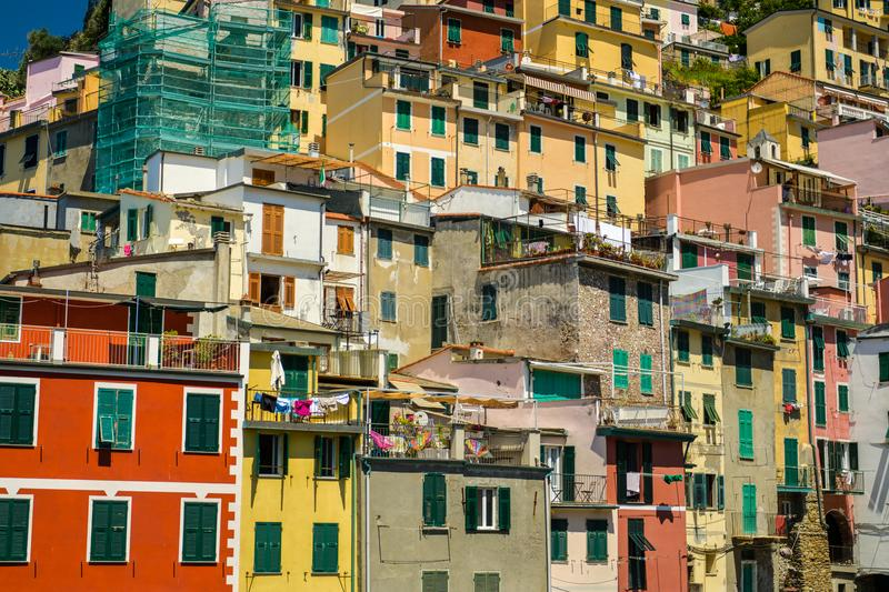 Colorful little houses in city of Riomaggiore. RIOMAGGIORE, ITALY - JUNE 29, 2018: Colorful little houses in city of Riomaggiore, Italy during June 2018 stock image