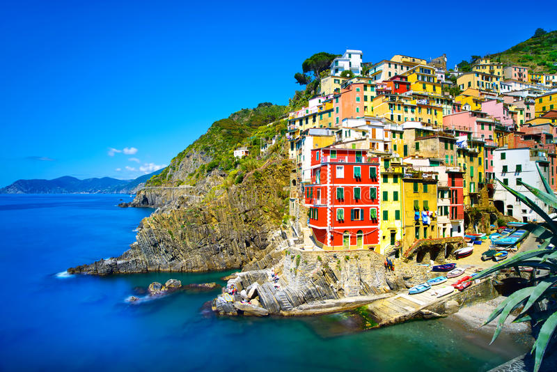 Riomaggiore village, rocks and sea at sunset. Cinque Terre, Ligury, Italy royalty free stock image