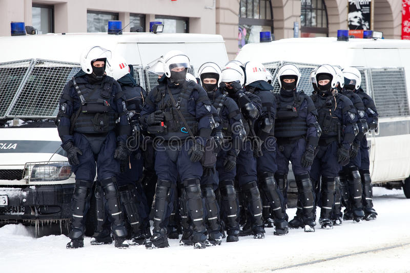 Riot Police. RIGA, LATVIA, MARCH 16, 2010: Riot police officers ready to prevent provocations at Commemoration of the Latvian Waffen SS unit or Legionnaires.The royalty free stock images