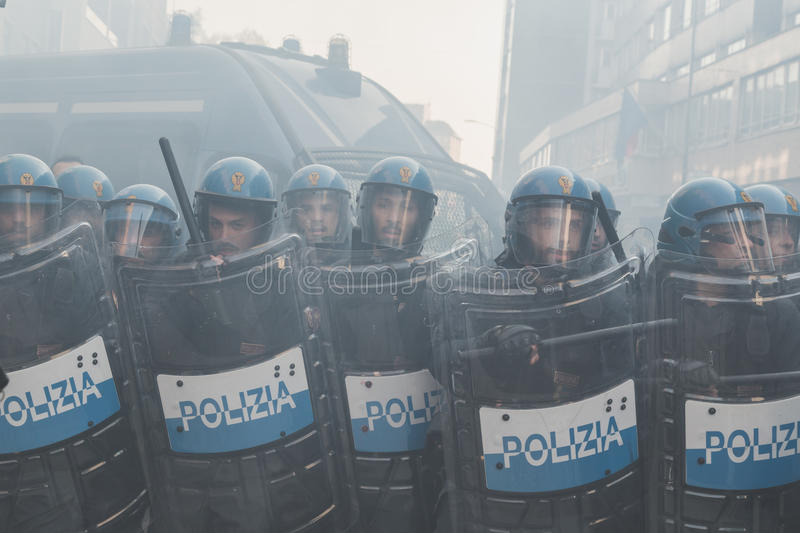 Riot police confronting the students in Milan, Italy. MILAN, ITALY - NOVEMBER 13: Riot police confronting the students during a march in the city streets to royalty free stock photo