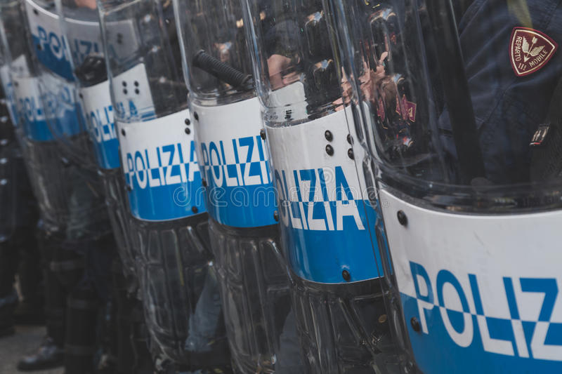Riot police confronting the students in Milan, Italy. MILAN, ITALY - NOVEMBER 13: Riot police confronting the students during a march in the city streets to stock photos