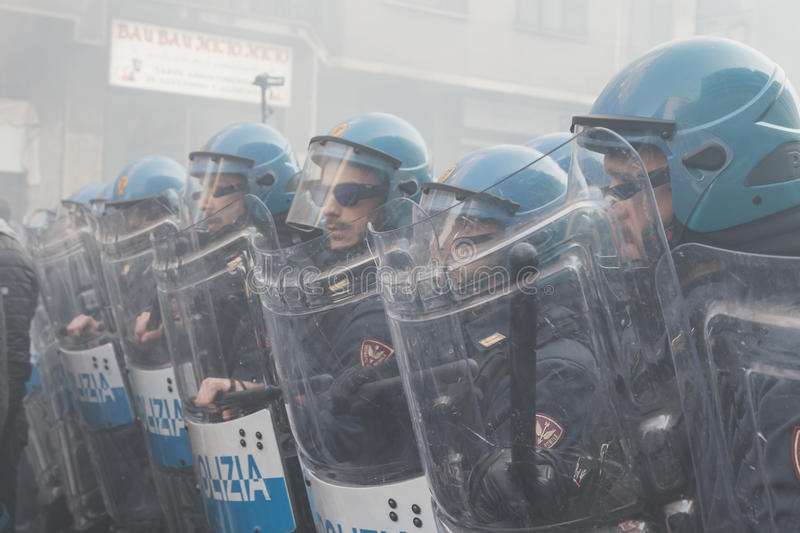 Riot police confronting the students in Milan, Italy. MILAN, ITALY - NOVEMBER 13: Riot police confronting the students during a march in the city streets to stock image