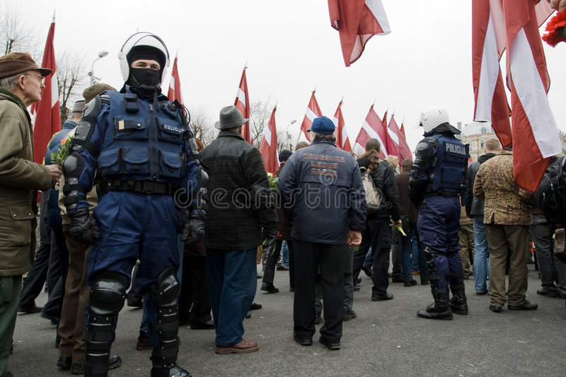Riot police in crowd. Riga, Latvia, March 16, 2009. Commemoration of the Latvian Waffen SS unit or Legionnaires.The event is always drawing crowds of nationalist royalty free stock images