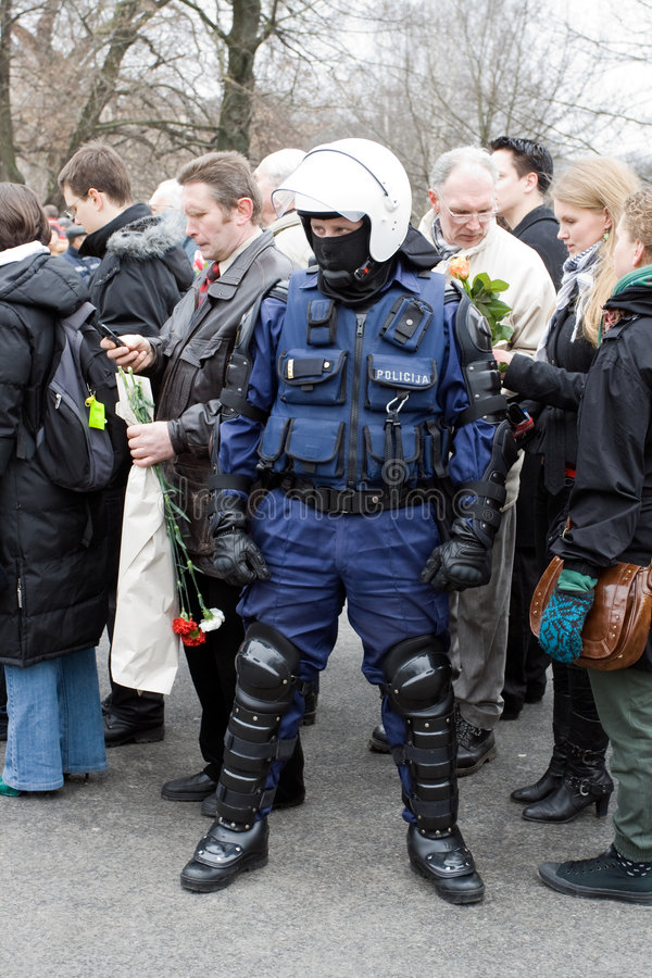Riot police in crowd. Riga, Latvia, March 16, 2009. Commemoration of the Latvian Waffen SS unit or Legionnaires.The event is always drawing crowds of nationalist stock image