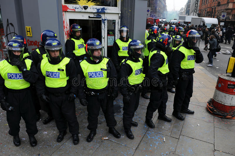 Riot Police Guard a Bank at Riot in London royalty free stock images