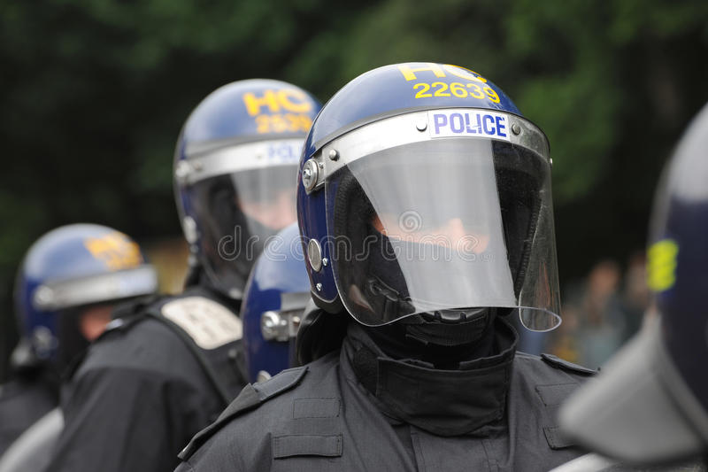 Riot police officer with face shield and helmet royalty free stock photography