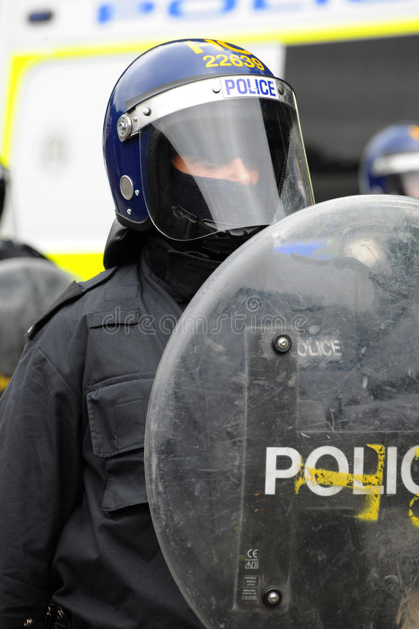 Riot police officer with shield and helmet royalty free stock photos