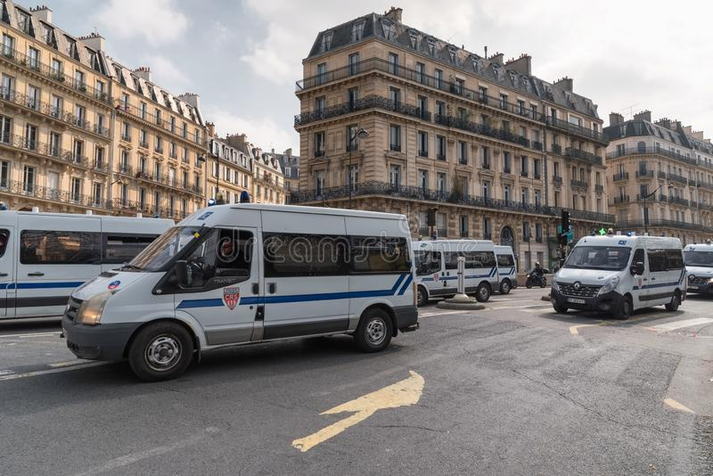 Riot police protecting Paris from violent attacks of yellow vests Gilets jaunes protesters. Paris, France - 22nd March, 2019: French police and armed forces stock photos