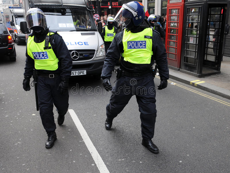 Riot Police at a Protest in London royalty free stock image