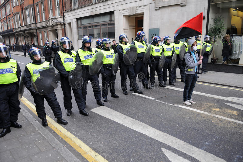 Riot Police and Protester in London royalty free stock photography