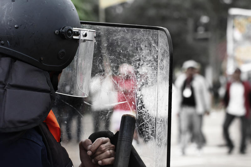 The riot police and protesters. The riot police and protesters on street stock images