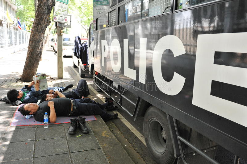 Riot Police Rest At Government House Editorial Image
