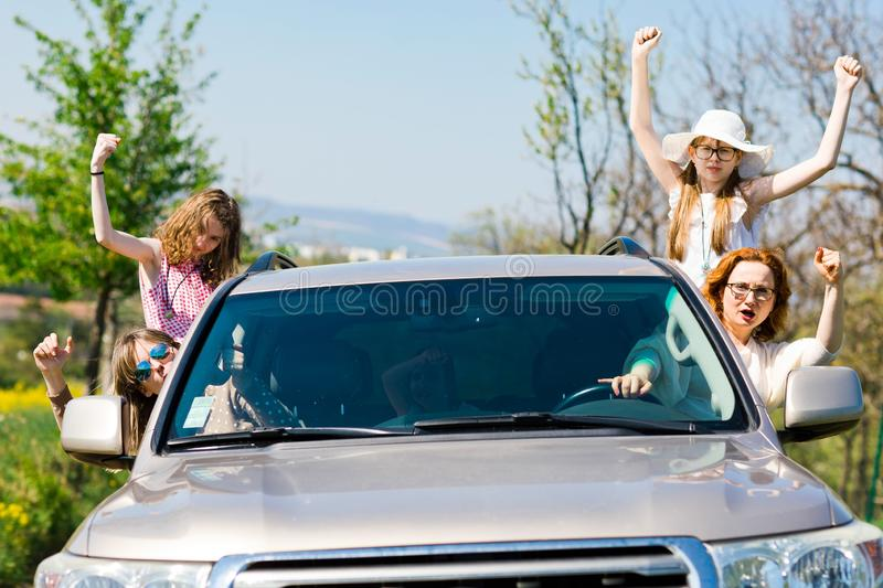 Rioters behind the wheel - female hooligans in the car stock image