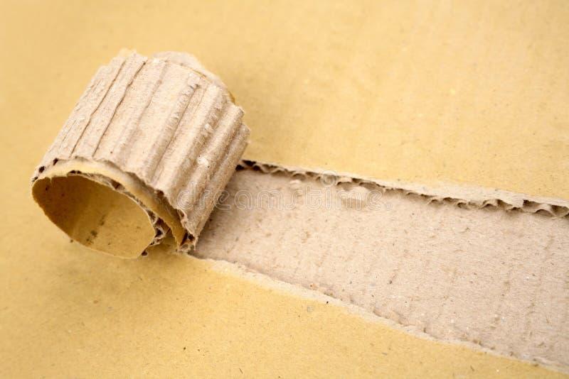 Rip in cardboard. Rip in piece of corrugated cardboard stock image