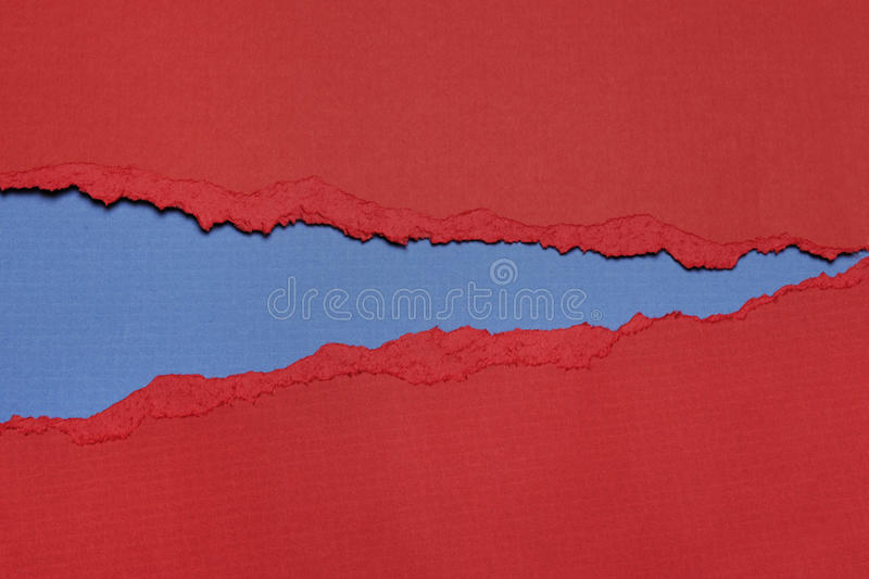 Rip Paper. Rip red Paper and blue bakground with space for text stock photography