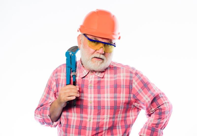 Riparazione e correzione dell'architetto Lavoratore dell'ingegnere configurazione e costruzione riparatore professionista in casc immagine stock