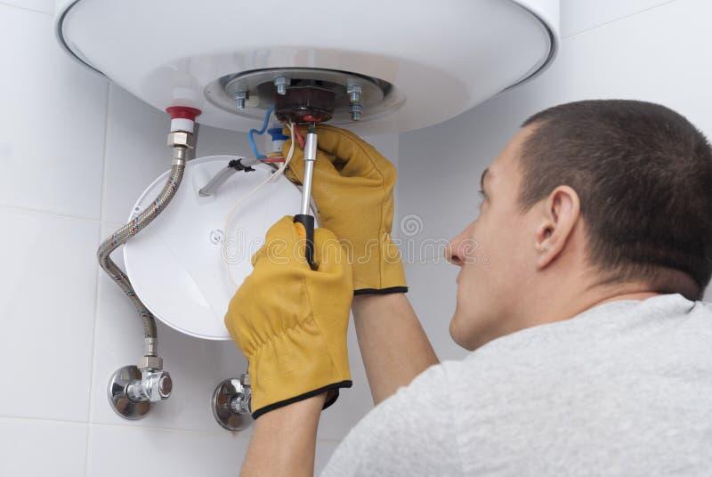 Ripari la caldaia elettrica immagine stock