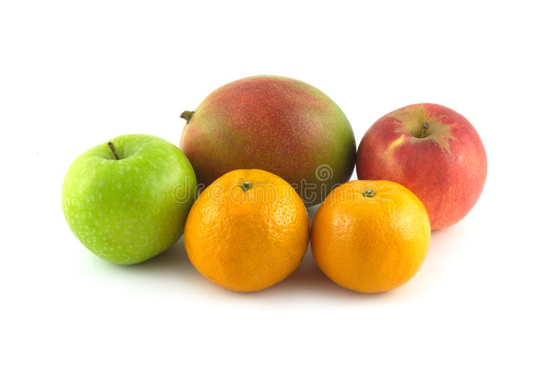 Ripe appetizing fruits: mango, apples and tangerines on white stock images