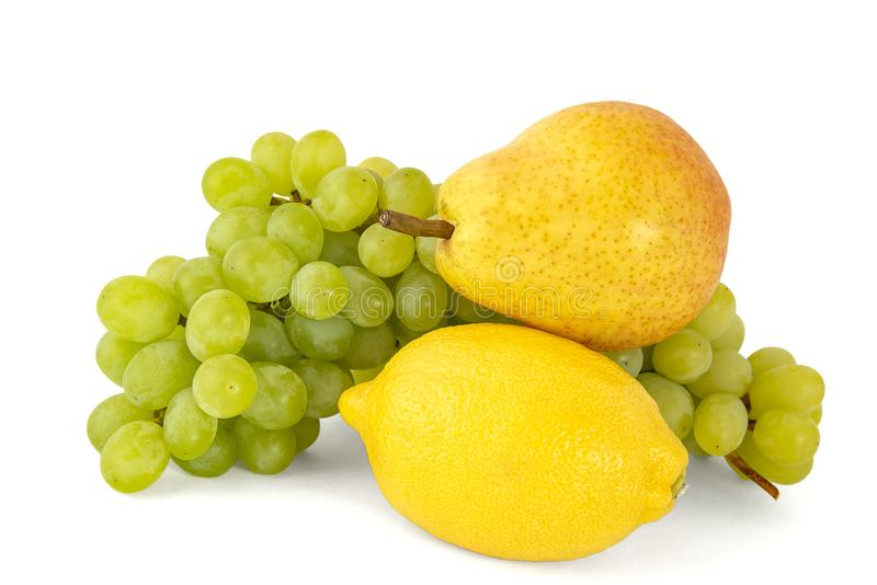 Yellow pear with lemon branch of green grapes on white background royalty free stock photos