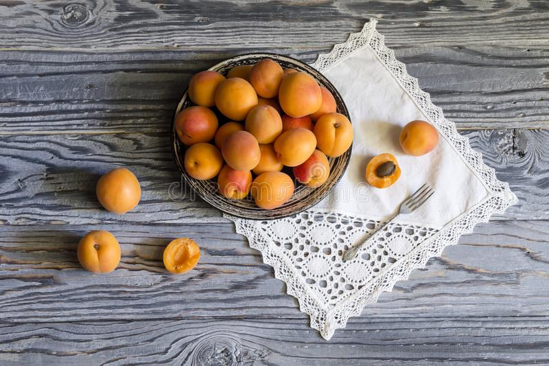 Ripe apricots on a plate. Fruits. Ripe apricots on a plate close-up on a wooden table royalty free stock photos