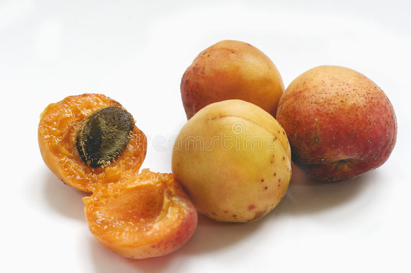 Ripe apricots on a white stock photography
