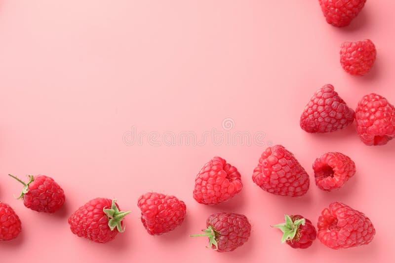 Ripe aromatic raspberries on color background stock photo