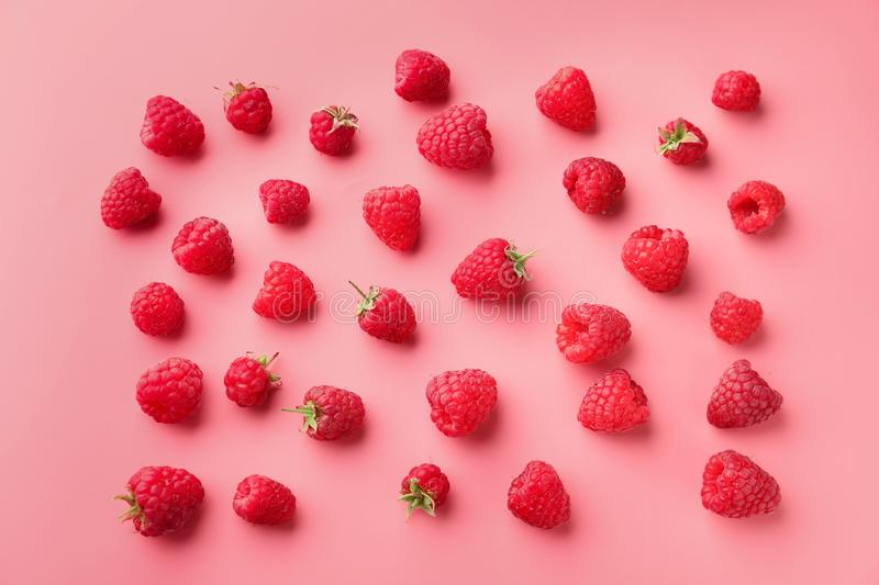 Ripe aromatic raspberries on color background royalty free stock photo