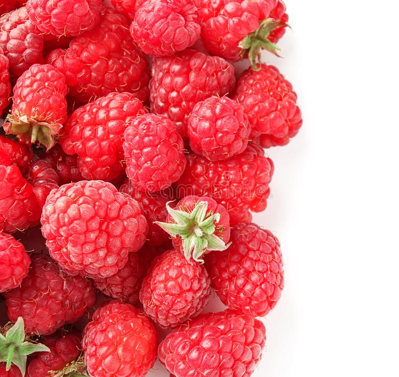 Ripe aromatic raspberries on white background stock images