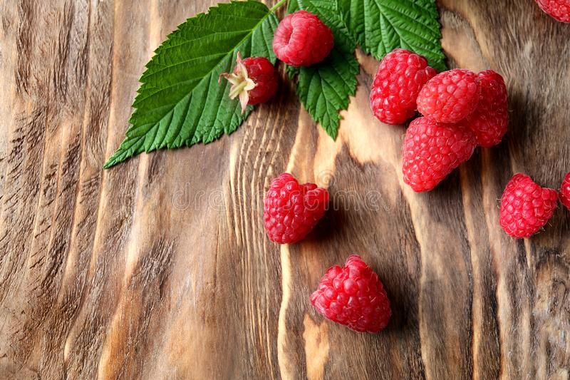 Ripe aromatic raspberries on wooden background royalty free stock images