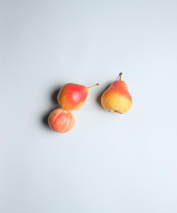 Ripe autumn pears and apples stock images