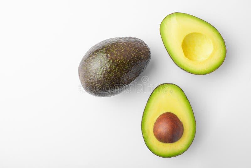 Ripe avocado sliced on white background, isolated royalty free stock photo