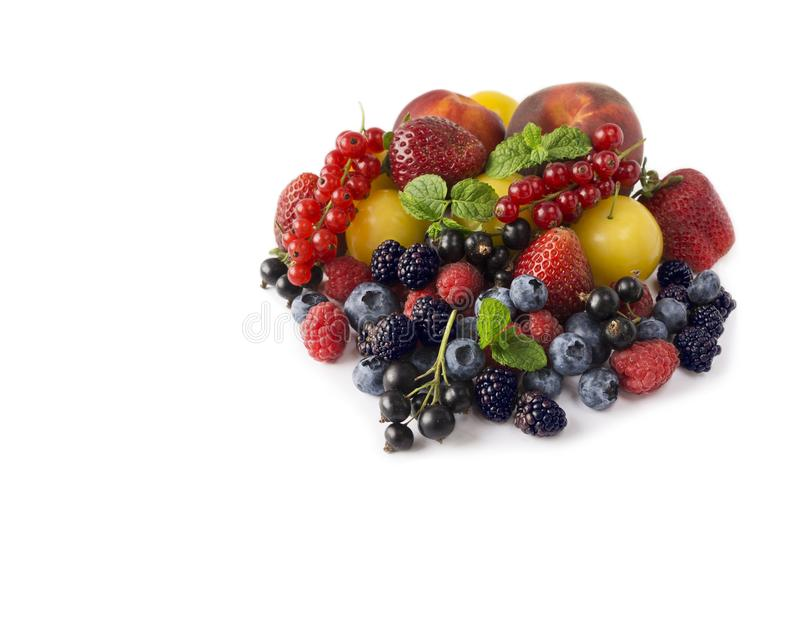 Various fresh summer berries isolated on a white background royalty free stock photo