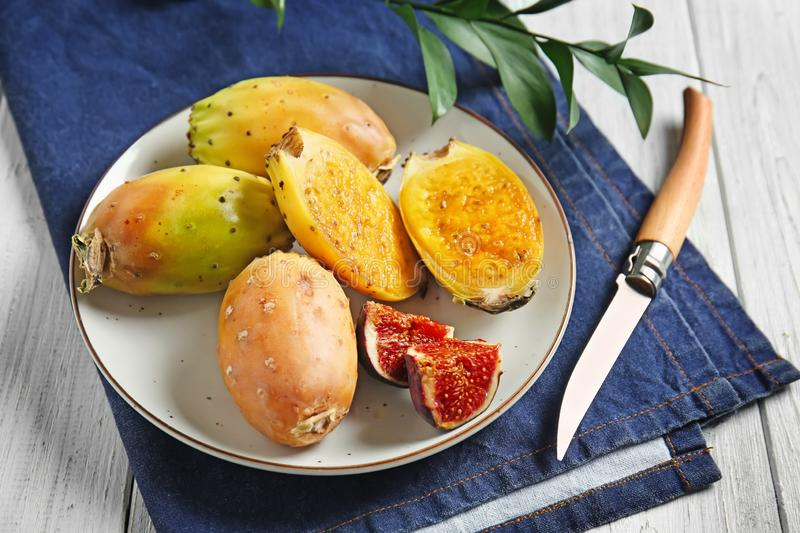 Ripe cactus pears with fig on plate stock image