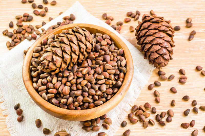 Ripe cedar cones and pine nuts in shell royalty free stock images