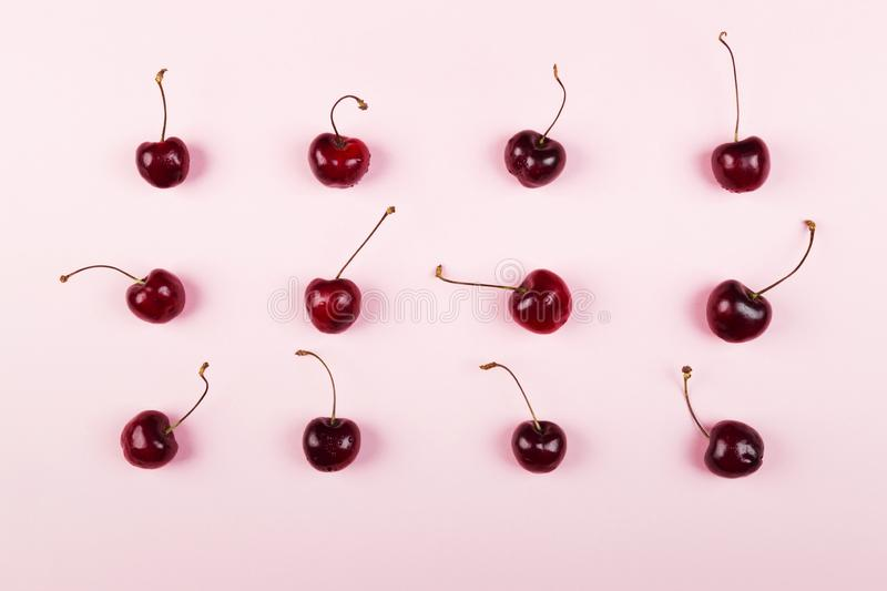 Ripe cherry on a pink background. Top view. Food background stock image