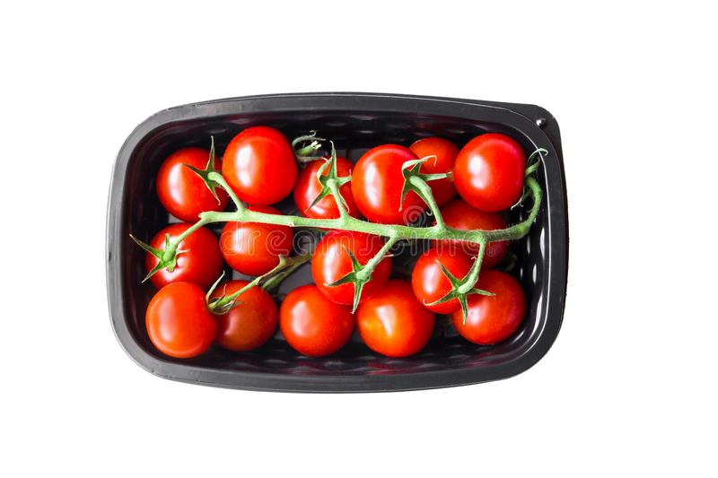 Ripe cherry tomatoes in plastic container royalty free stock images