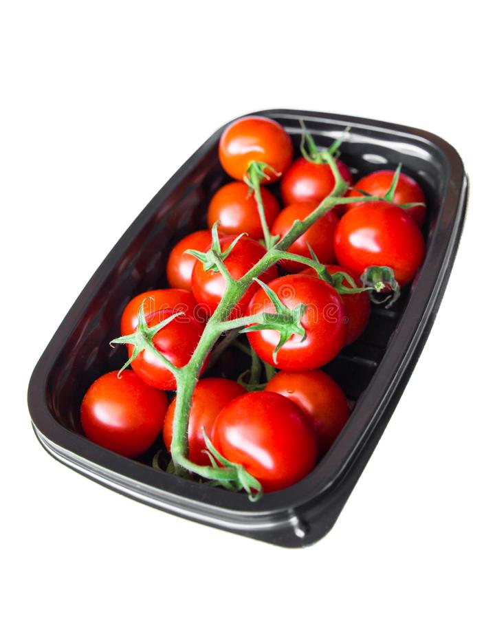 Ripe cherry tomatoes in plastic container royalty free stock photography