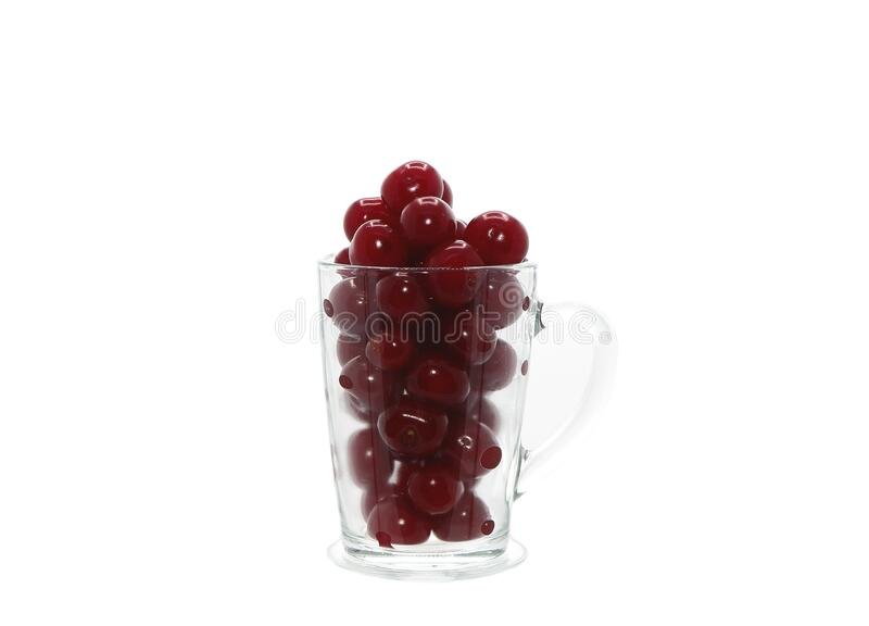 Ripe cherry in a transparent glass on a light background. royalty free stock photo