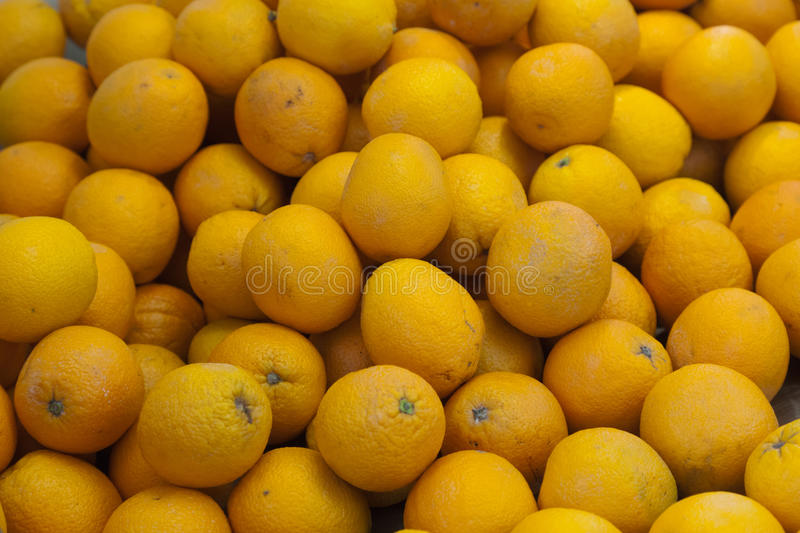 Ripe citron fruit. Pile of ripe yellow citron fruit on market stall in Spain stock image
