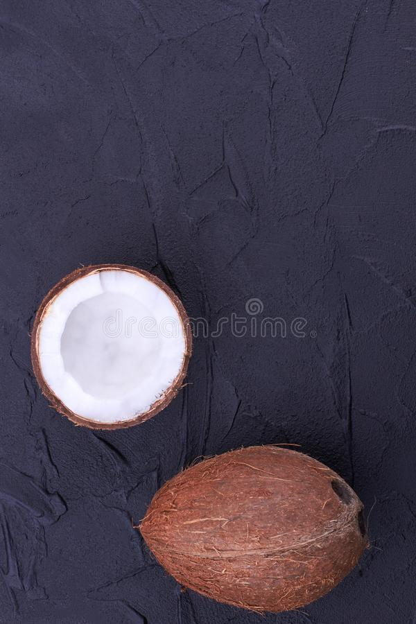Ripe coconuts on black background, top view. royalty free stock images